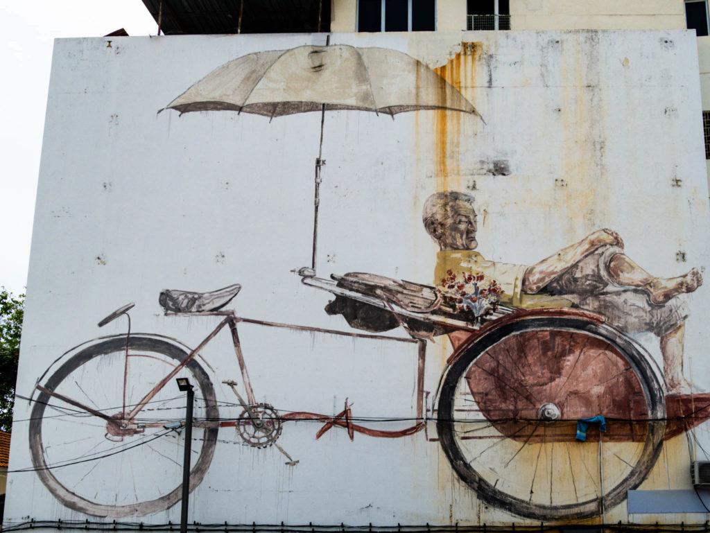 L'homme au trishaw, ce tricycle servant à transporter les touristes aujourd'hui